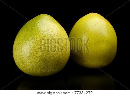 Two Pomelos Chinese Grapefruits Isolated On Black