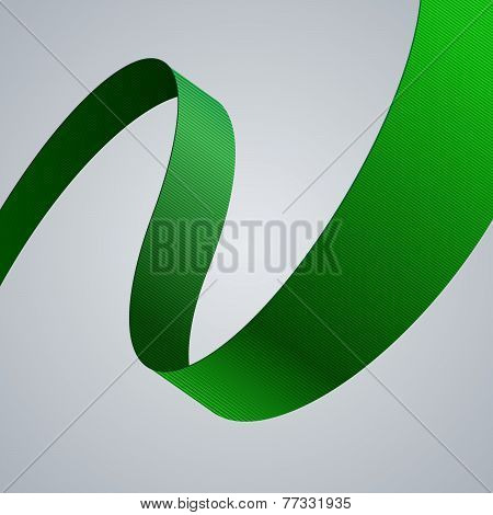 Green fabric curved ribbon on grey background