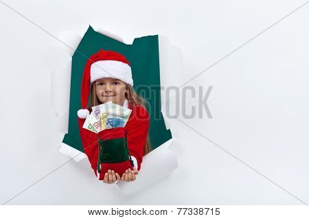 Little santa giving you money for the holiday season - leaning through hole in blank board
