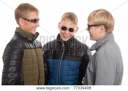Group of young guys communicate with each other. Two of the boys twin brothers.