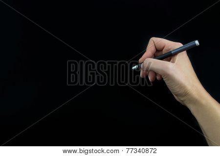 Hand Holding Stylus Isolated On Black Background