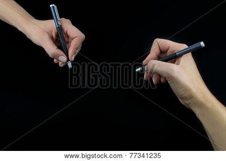 Hand Holding Stylus Isolated On Black