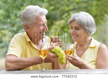 The old couple drinking wine
