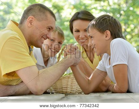 Family outdoors at table