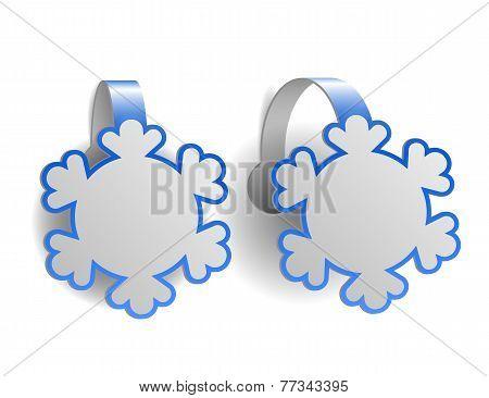 Blue advertising wobblers shaped like snowflakes