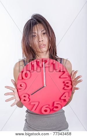 Tired Asian Woman Holding Clock