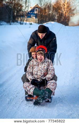 young people fun sledding