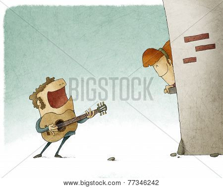 man singing and playing guitar
