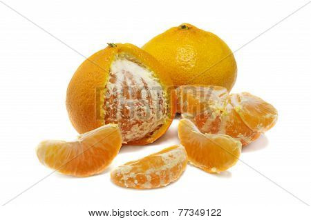 Close Up Of Fresh Orange Mandarine And Wedges Isolated Over White