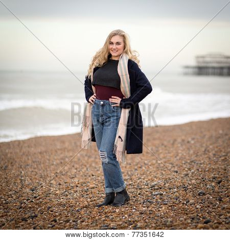 Confident Blond Teenage Girl Alone On A Cold Beach