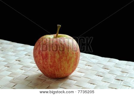 Apple on grass mat