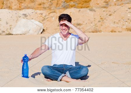 Young Man Shielding His Eyes In Desert
