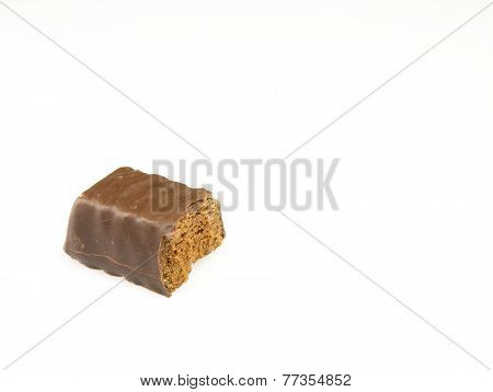 Bitten Chocolate Candy On A White Background.
