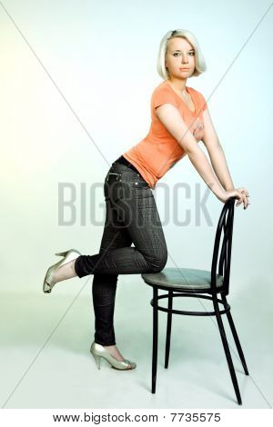 Portrait Of The Attractive Girl With Chair