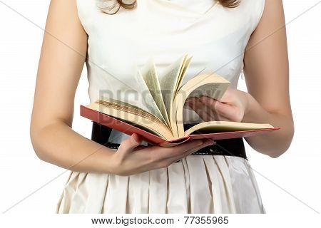 Image of the book in woman's hands