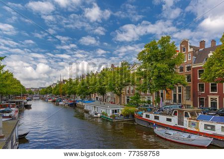 City View Of Amsterdam Canalsand Typical Houseboats, Holland, Netherlands.