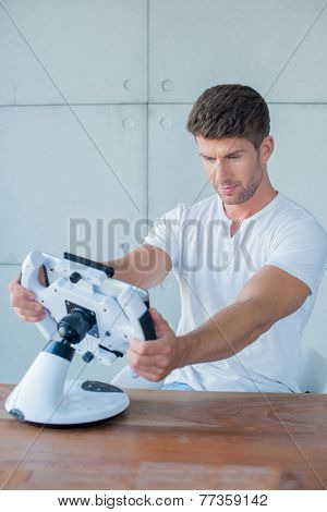 Handsome man playing on his gaming console