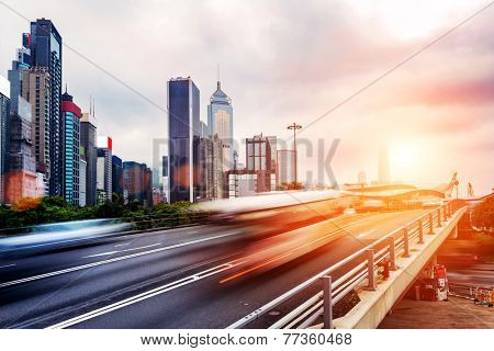 cityscape and traffic trails on the road of modern city