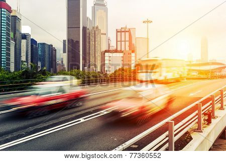 cityscape and traffic trails in hongkong.