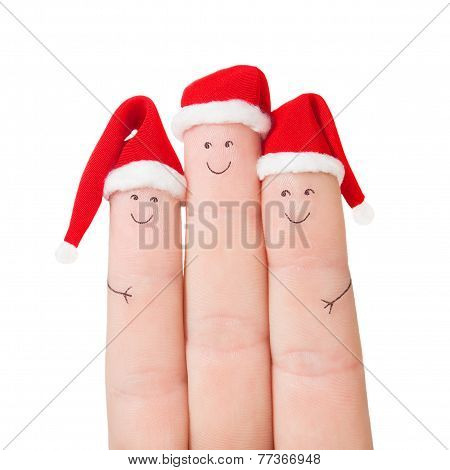 Fingers Faces In Santa Hats. Happy Family Celebrating Concept For Christmas Or New Years Day
