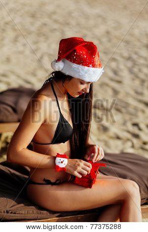 Santa Girl In Bikini  Unpacking Christmas Gift