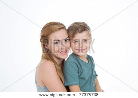 Portrait Of Boy And Girl On Empty Background