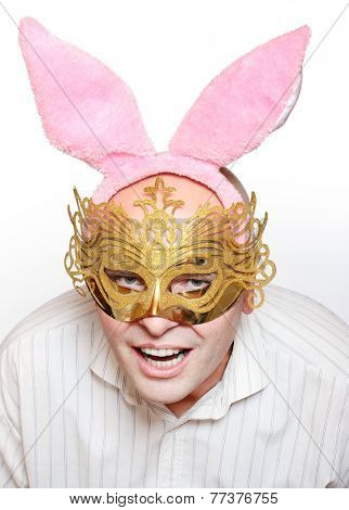 Funny picture of man in love with paper mask and rabbit ears.