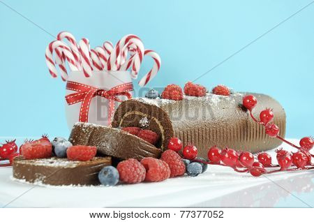 Christmas Holiday Chocolate Roulade Swiss Roll With Berries Dessert Party Food In Modern Red And Whi