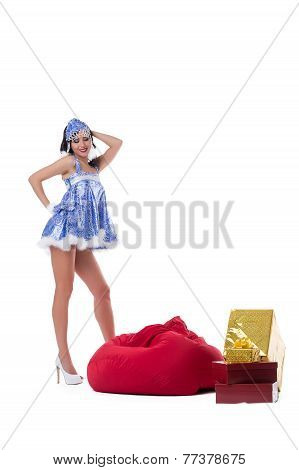 Sexy Snow Maiden posing with bag of gifts