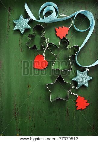 Christmas Holiday Background With Red, White, Festive Decorations And Cookie Cutters Against A Vinta