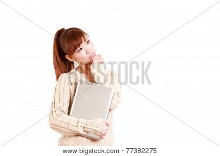 woman with laptop computer thinks