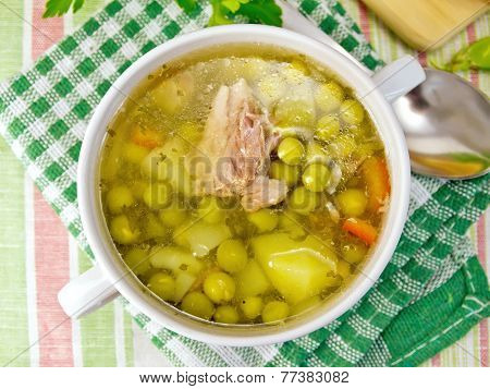 Soup Of Green Peas With Meat On Tablecloth