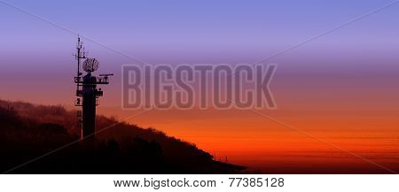 Silhouette Of A Radar Station On The Polish Coast At Sunset.
