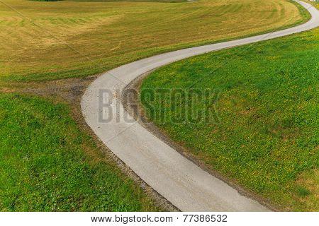 Winding Road In The Green Field
