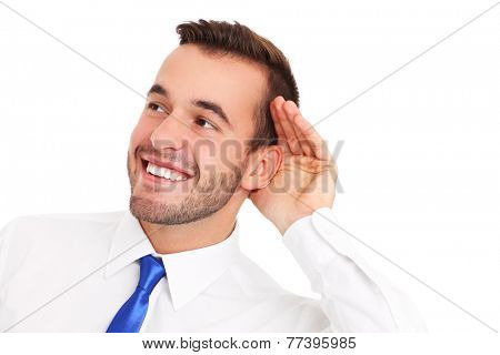 A picture of a happy businessman listening to something over white background