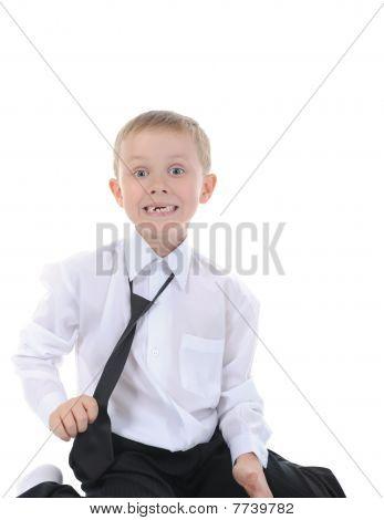 Happy Little Boy Sitting On The Floor.