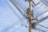 stock photo of utility pole  - image of busy line on electric pole  - JPG