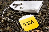 foto of tea bag  - close up picture of tea bag and dried black tea leaves - JPG