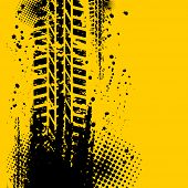 picture of skid  - Orange grunge background with black tire track - JPG
