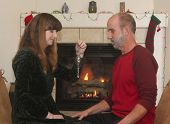 stock photo of cozy hearth  - A Married Couple Sit in Front of a Fireplace at Christmas  - JPG