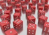 stock photo of dice  - tens of reds dice arranged in a random position - JPG