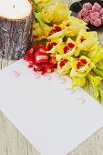 foto of gladiolus  - blank sheet of paper yellow gladiolus large candle and candy on a wooden background - JPG