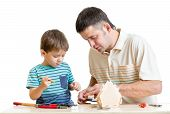 picture of nesting box  - Father and son make nesting box together isolated - JPG