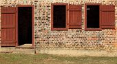 stock photo of slave  - Close up of front door of old brick slave quarters - JPG