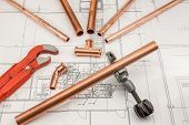 foto of pipe wrench  - Plumbing Tools Arranged On House Plans whit wrench and pipe cutter - JPG