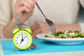 pic of water cabbage  - Alarm clock and dietary food on table close - JPG