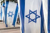 picture of israeli flag  - israeli flags held vertically during independence day ceremony - JPG