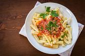 pic of italian parsley  - dish of italian pasta topped with tomato sauce and parsley - JPG
