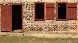 picture of slave-house  - Close up of front door of old brick slave quarters - JPG