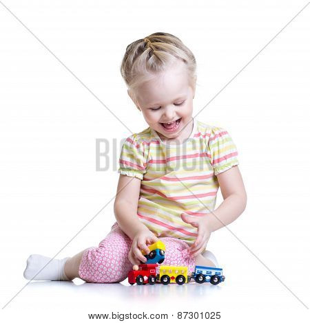 child girl playing with color toys